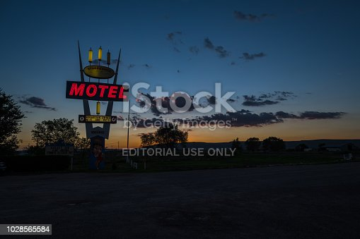Route 66, August 3, 2018. American Motel with neon​ sign on at Sunset