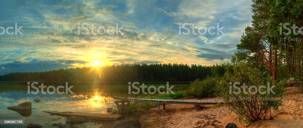 Sunset on shore of lake royalty-free stock photo
