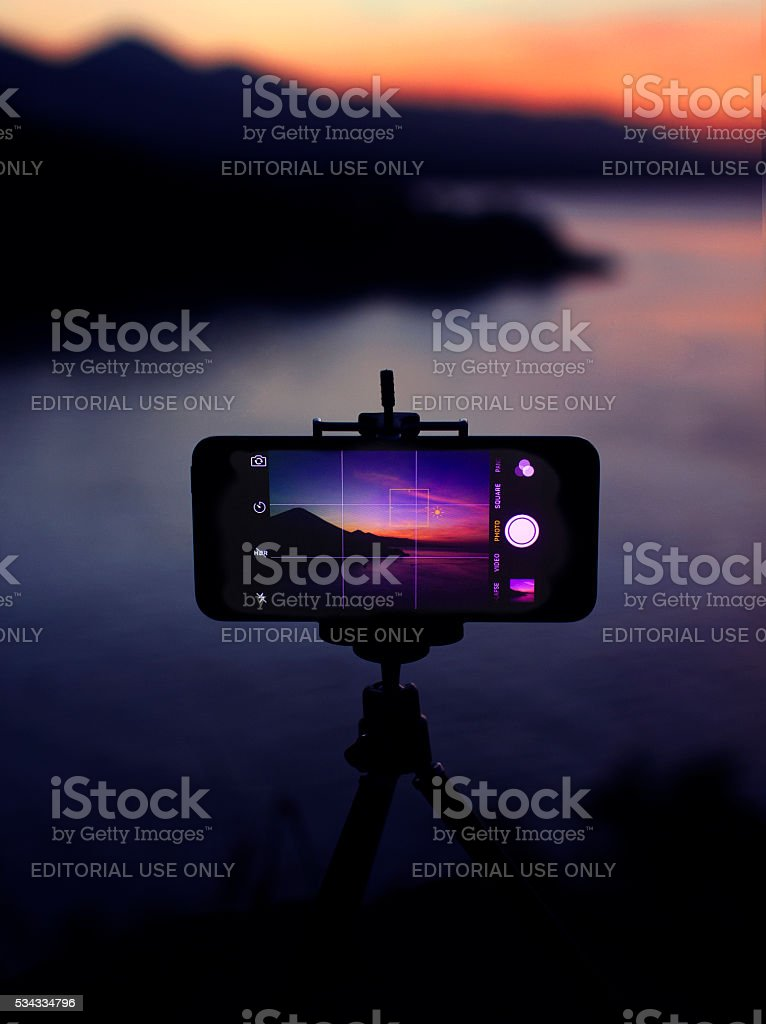 Sunset on smartphone stock photo