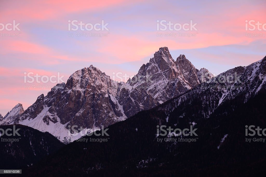 Sunset on snowy dolomites in San Candido, Innichen stock photo