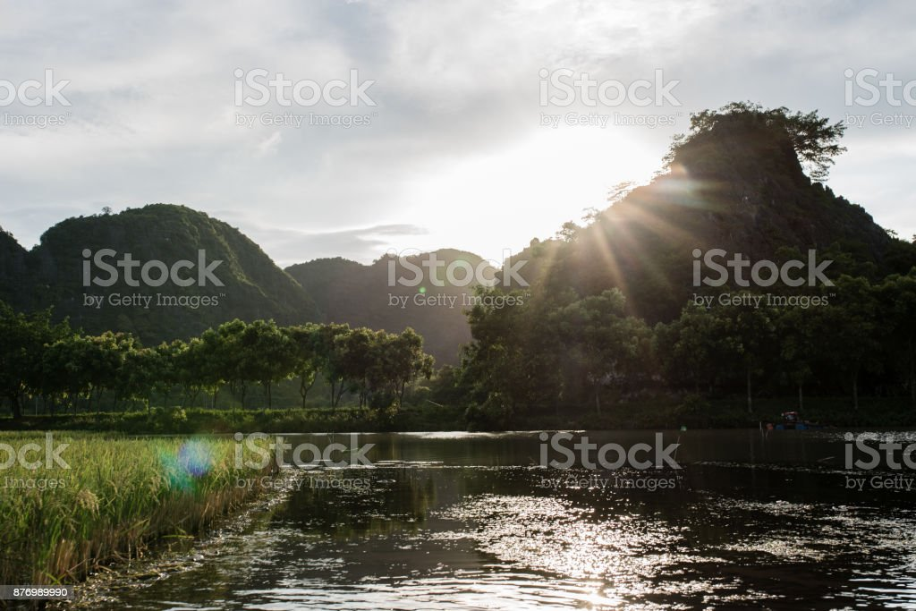 Sunset on Tam Coc river stock photo