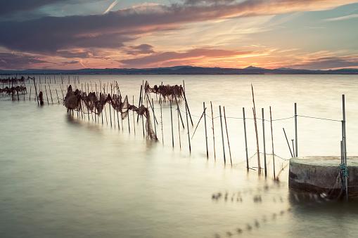 Sunset on the Albufera Nature Park, Valencia, Spain, with fishin