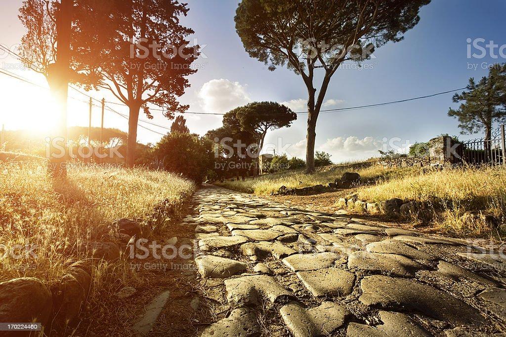 Sunset on the Appian way stock photo