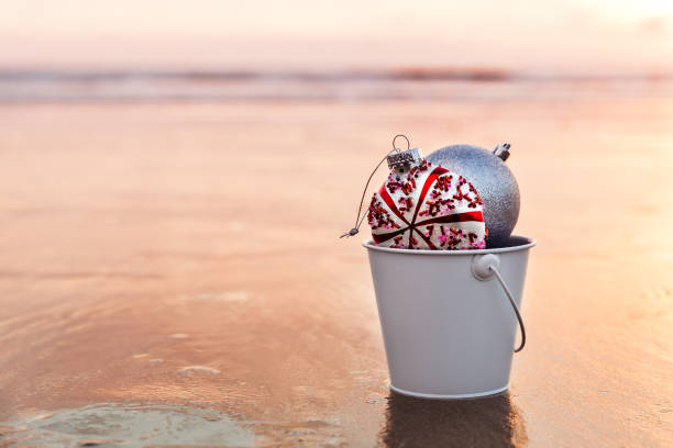 Sunset on the beach and Christmas decorations stock photo
