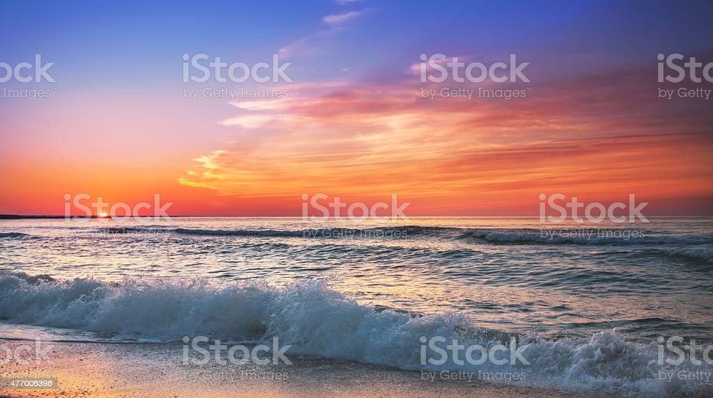 Sunset on the beach of caribbean sea. stock photo