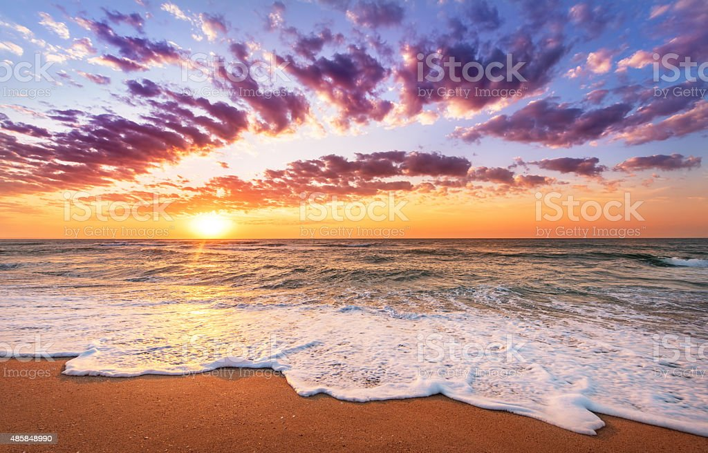 Sunset on the beach of caribbean sea. stock photo
