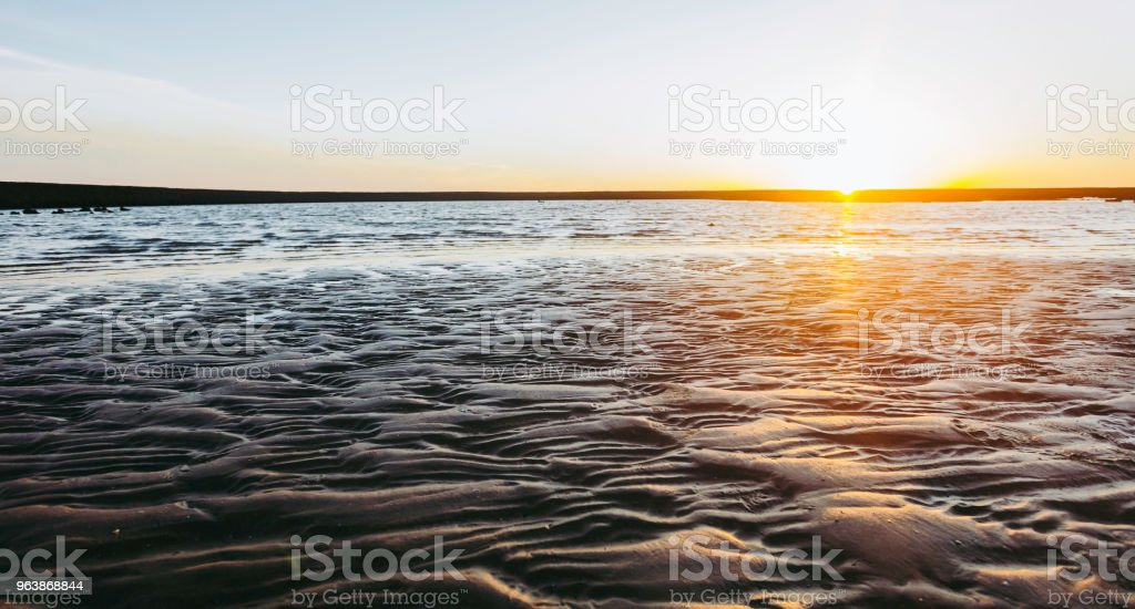 Sunset on the beach of Sanlucar de Barrameda, - Royalty-free Andalusia Stock Photo