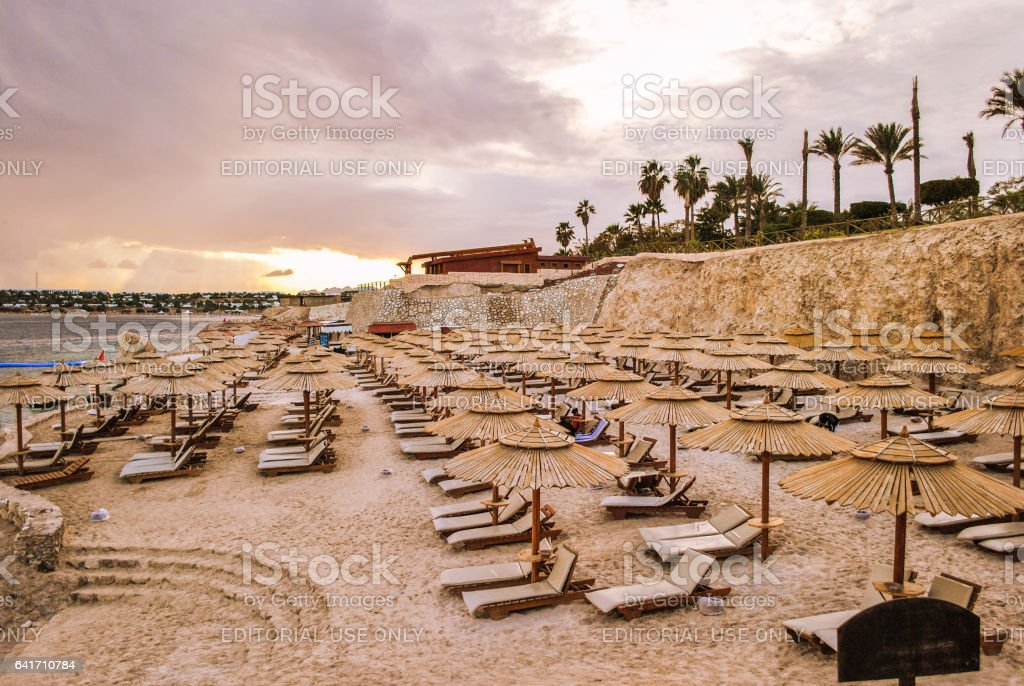 Hurghada, Egypt - January 23, 2011: Sunset on the beach of the Red Sea in Hurghada stock photo