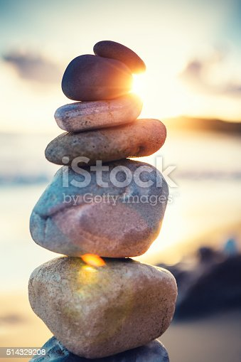 Stack of balanced stones on a beautiful sandy Avithos beach (Kefalonia, Greece).