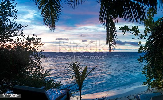 istock Sunset on the beach with a lot of plants 912430394