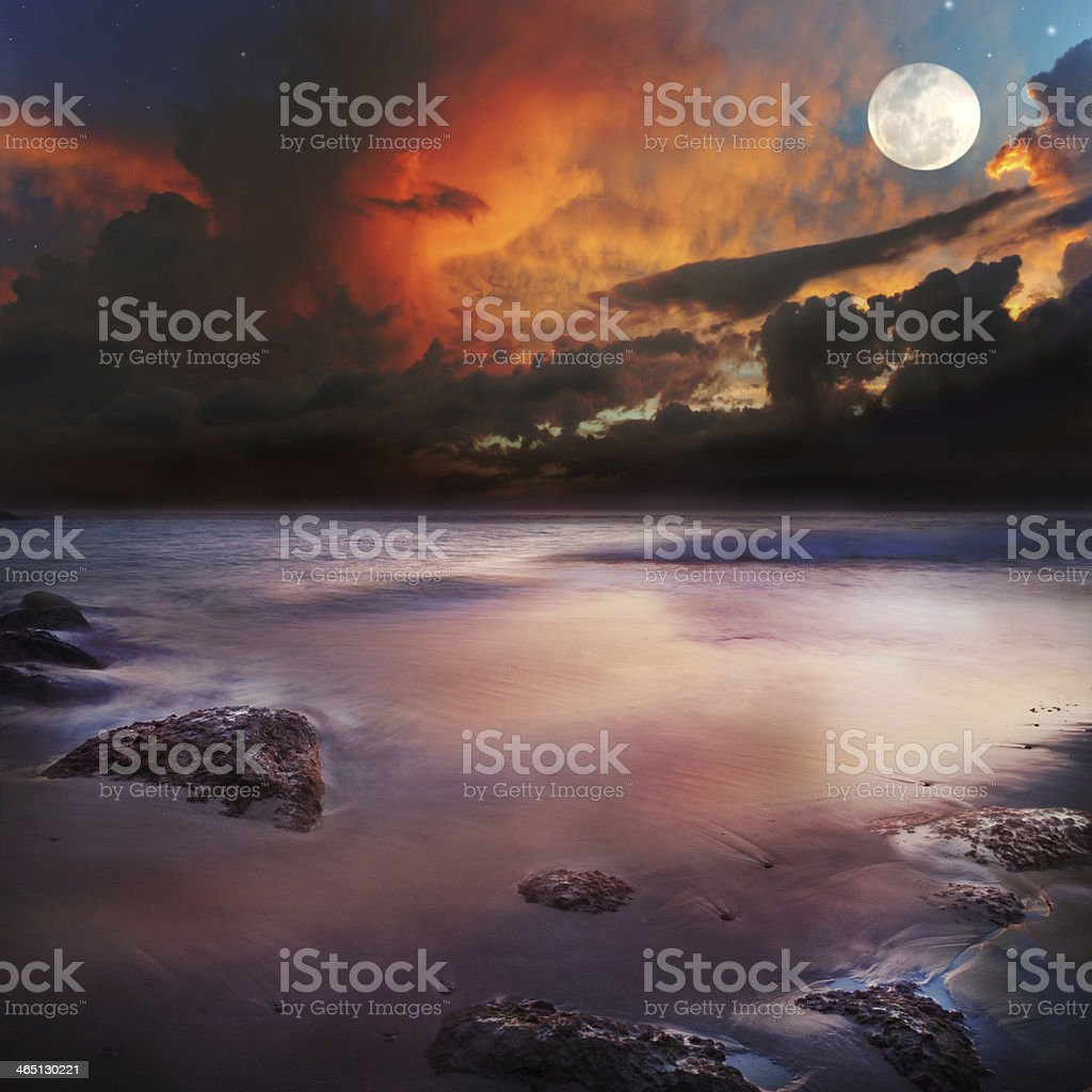 Sunset on the beach with view to ocean and sky stock photo