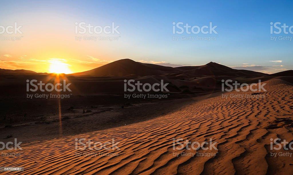 Sunset on the desert stock photo