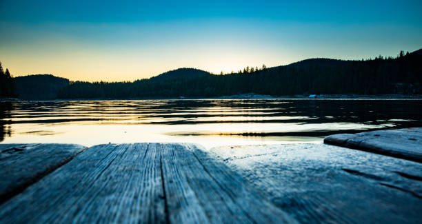 Sunset on the dock of Lois Lake stock photo