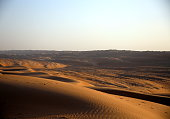 Sunset on the expanse of dunes in the Omani desert, Wahiba Sands / Sharqiya Sands, Oman