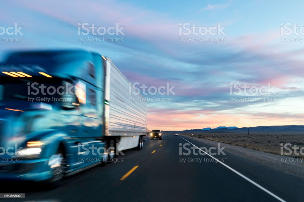 Sunset on the Long Haul Highway stock photo
