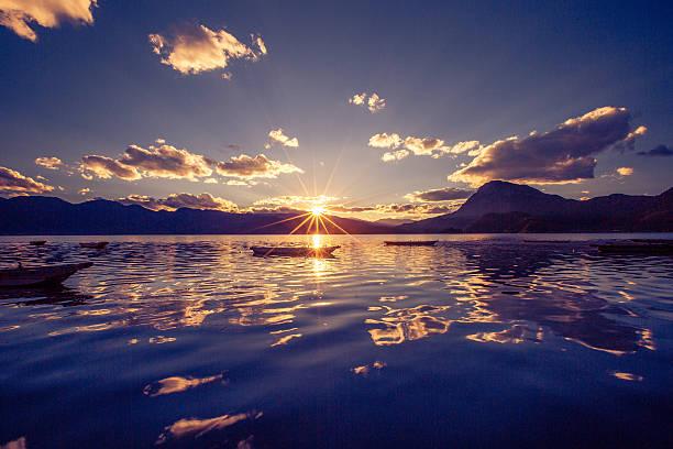Sunset on the Lugu lake stock photo