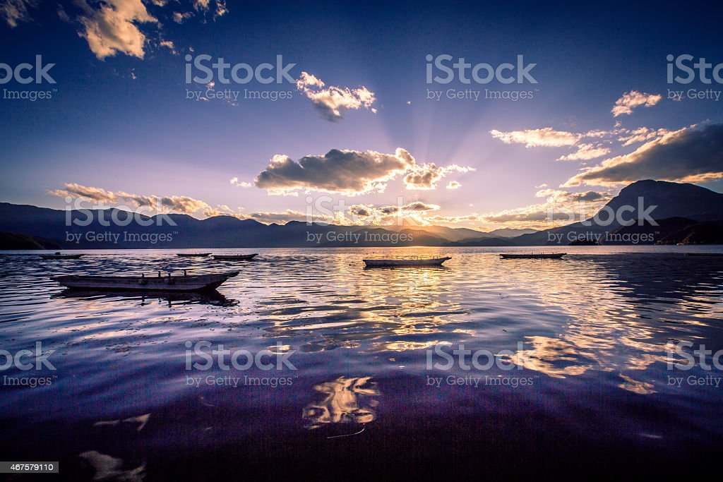 Sunset on the Lugu lake stock photo