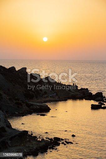 A sunset on the Mediterranean sea at ghajn tuffieha