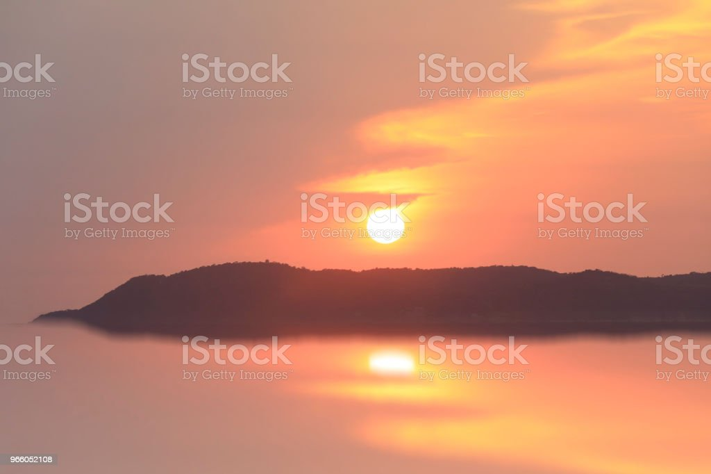 sunset on the mountain with reflection on water and bird flying back home - Royalty-free Abstract Stock Photo