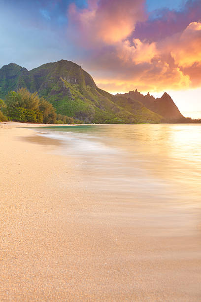 sunset on the north shore of kauai-tunnels beach, hawaii stock photo