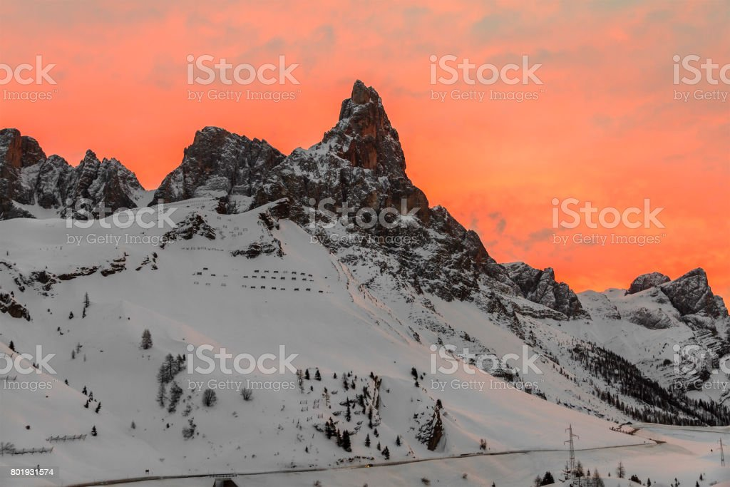 Sunset on the Pale di San Martino Natural Park in winter, Italy stock photo