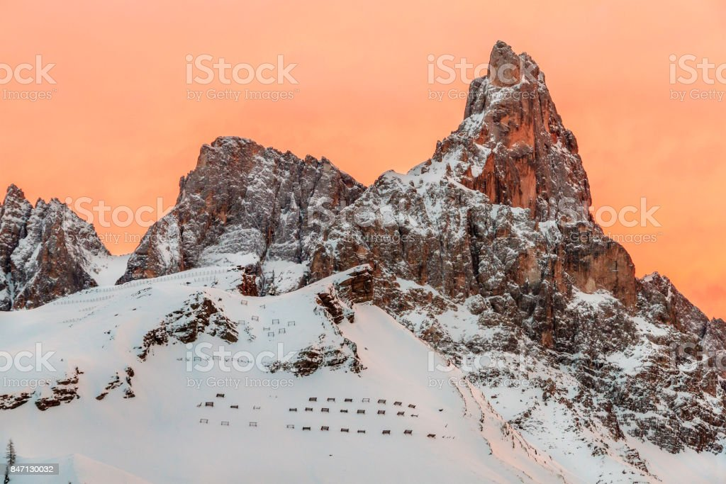 Sunset on the Pale di San Martino Natural Park (Pala Group) in winter, Italy stock photo