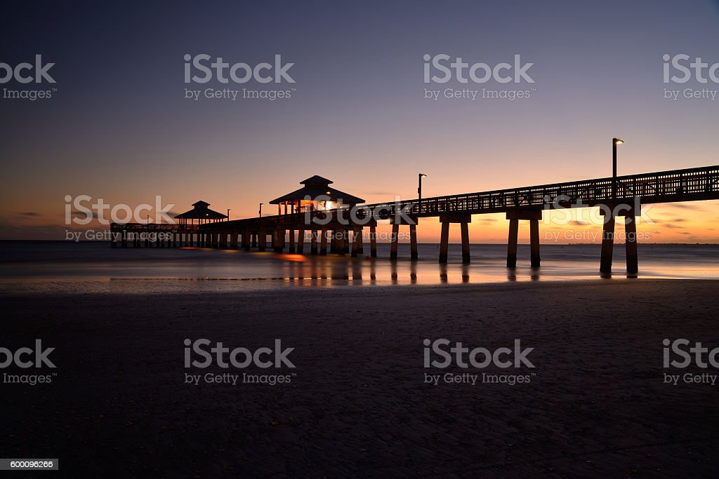 Sunset on the Pier from Fort Meyers Beach,Florida,USA. stock photo