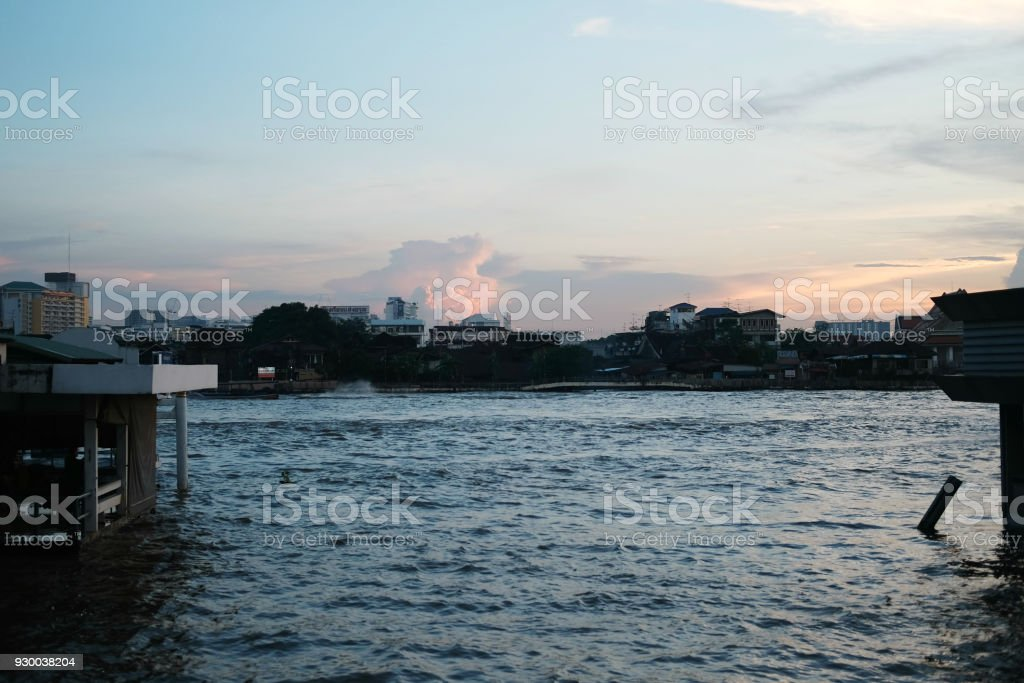 Sunset on the river at the port stock photo