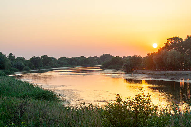 sunset on the river - river stock pictures, royalty-free photos & images