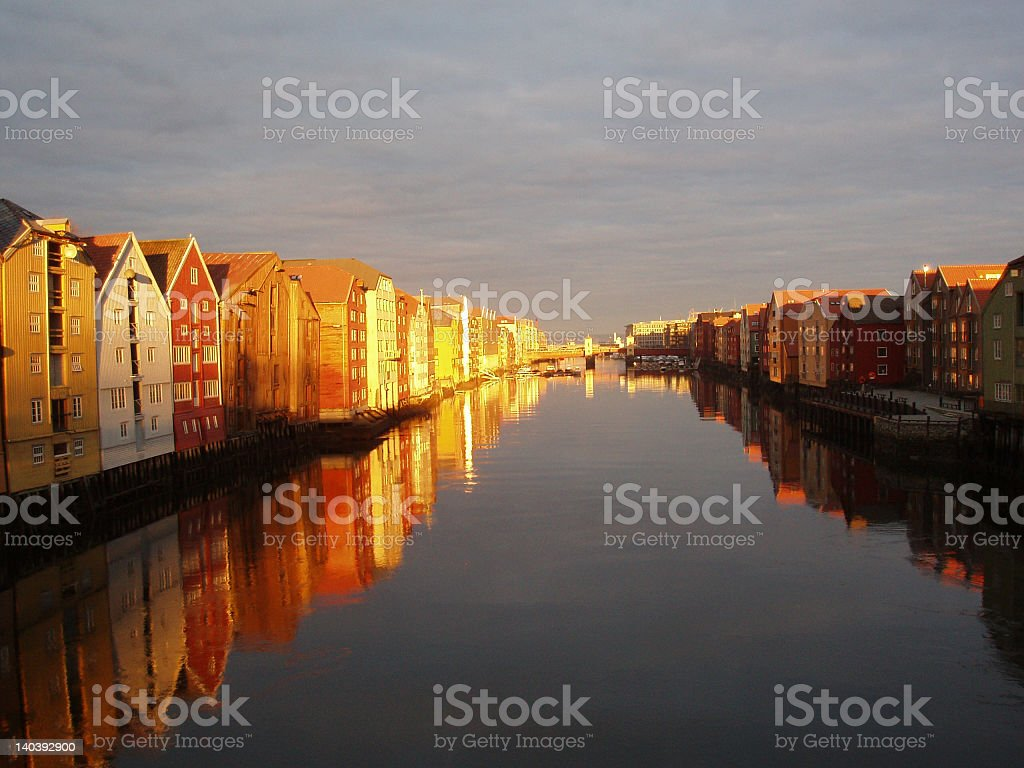 A sunset on the river with the reflection of the community stock photo