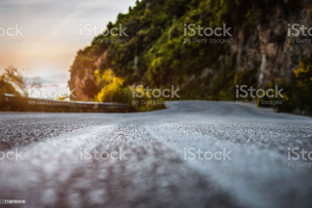 Sunset on the road near sea