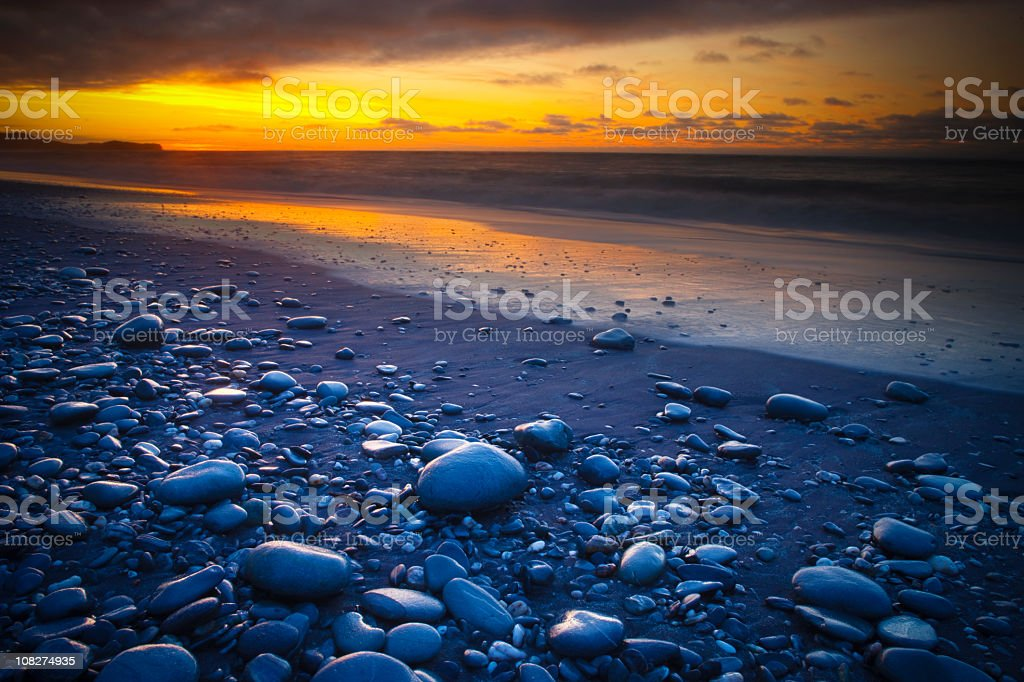 Sunset on the Rocky Beach royalty-free stock photo