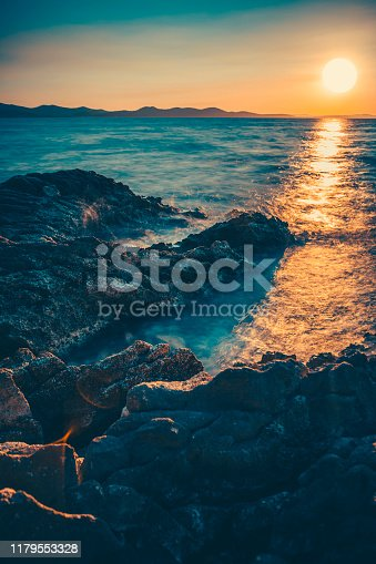 Sunset on the rocky coast of the sea