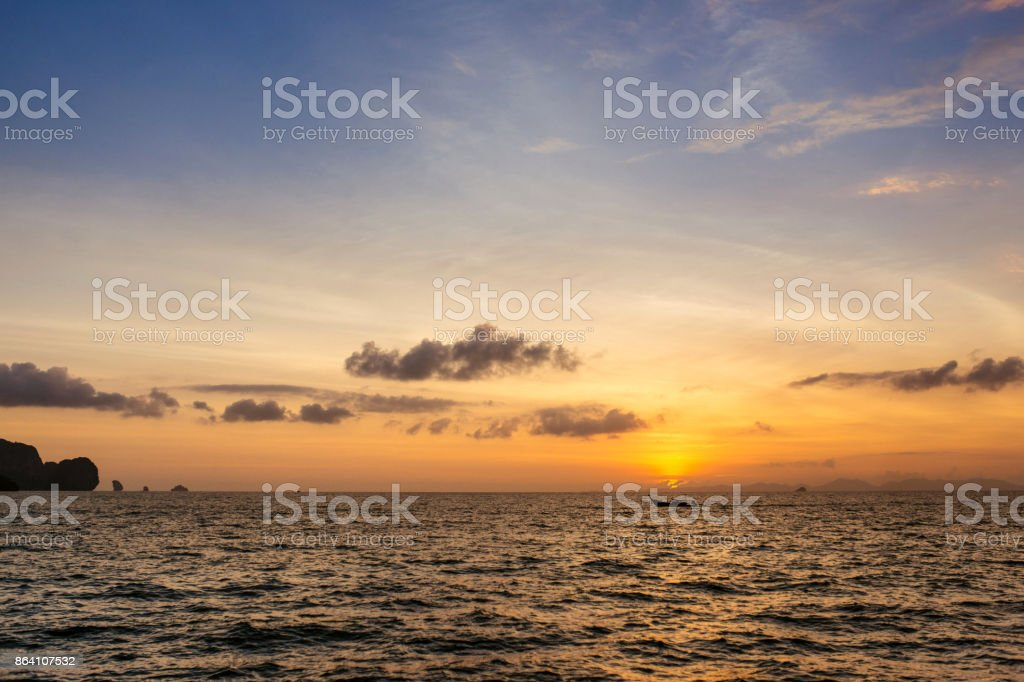 Sunset on the sea. Boat at sunset royalty-free stock photo