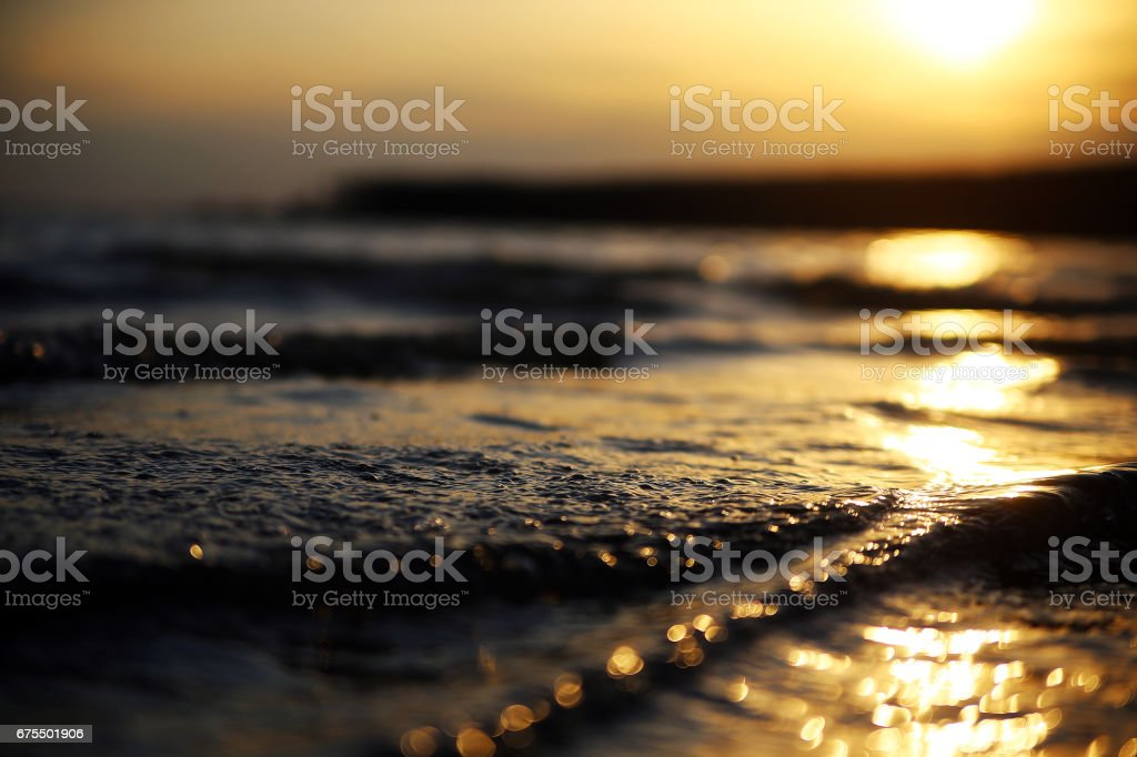 Sunset on the sea. The path from the sun on the waves in the ocean. The Golden sun reflection in the water on the lake at dawn. royalty-free stock photo