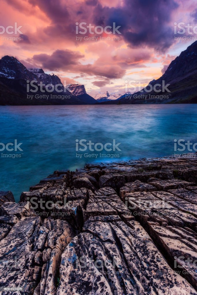Sunset on the shore of St Mary Lake in Glacier National Park, Mo stock photo