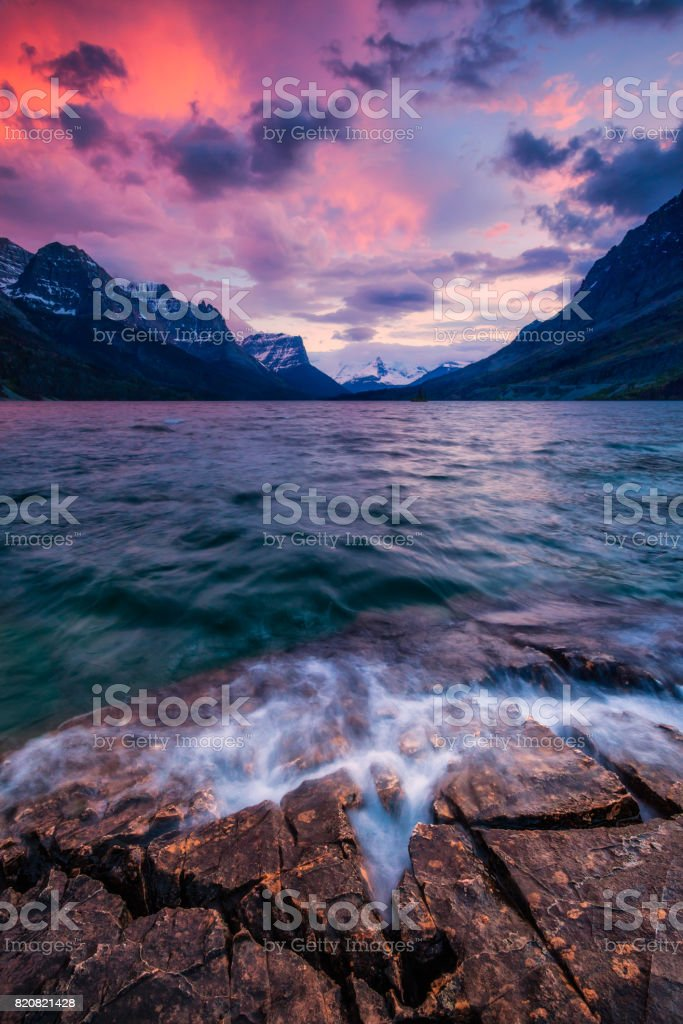 Sunset on the shore of St Mary Lake in Glacier National Park, Montana, USA stock photo