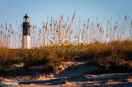 Tybee Island Lighthouse on the Atlantic Ocean in Georgia at sunset - horizontal