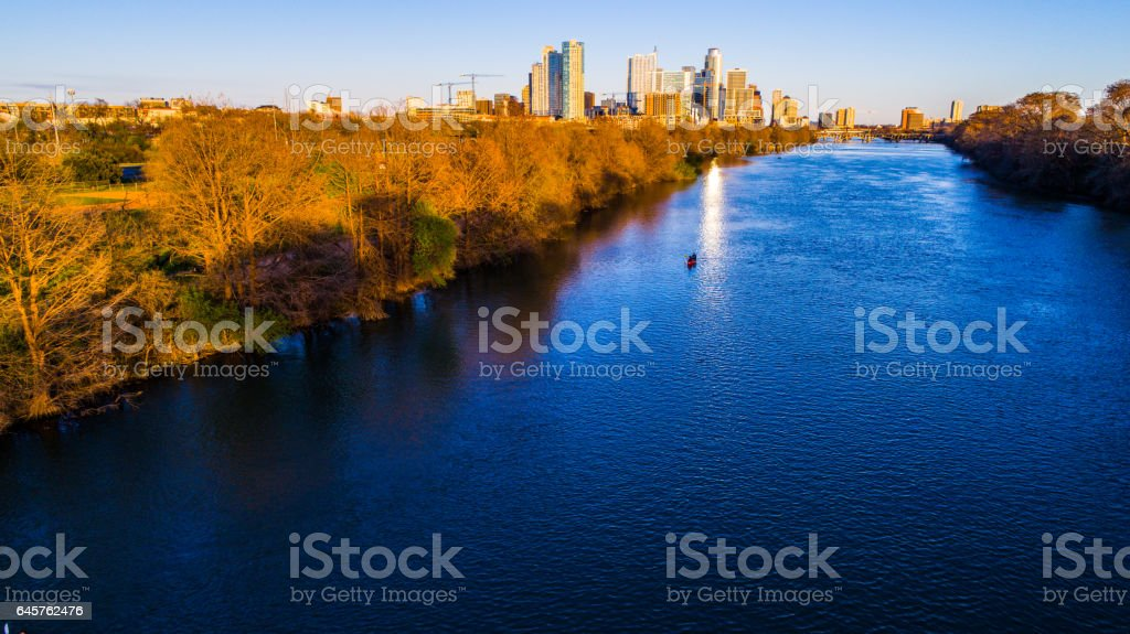 Sunset on Town Lake as the golden rays hit the rivers edge stock photo