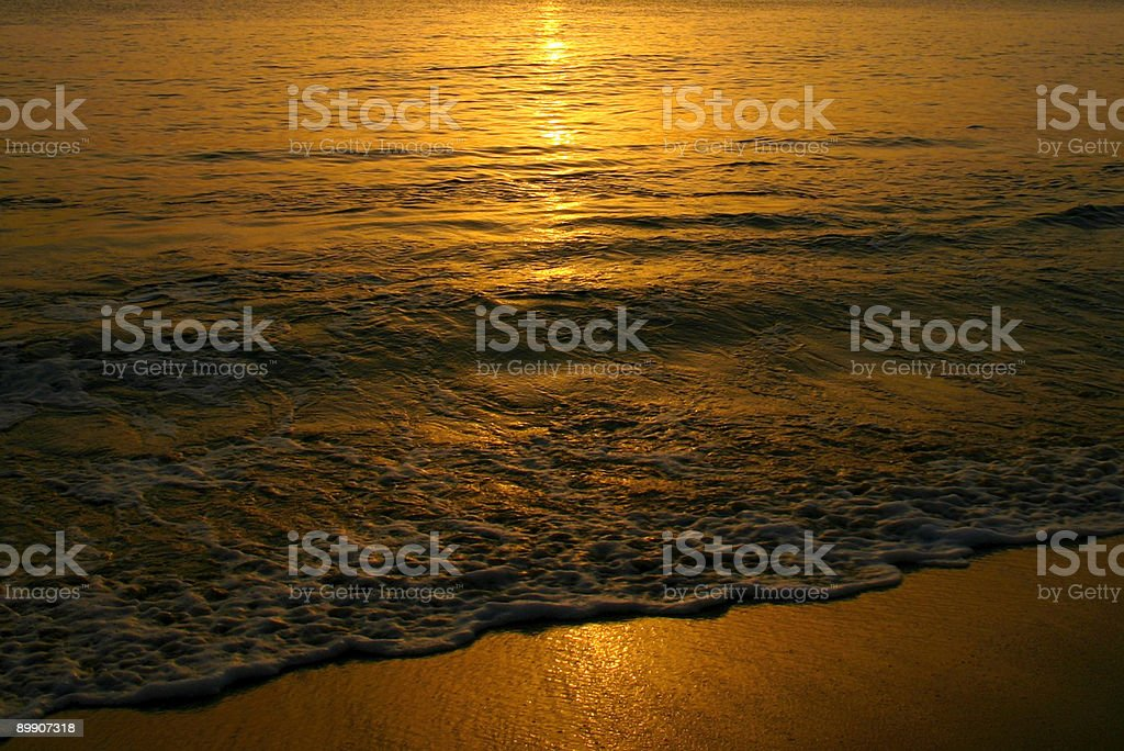 Sunset on tropical beach royalty-free stock photo