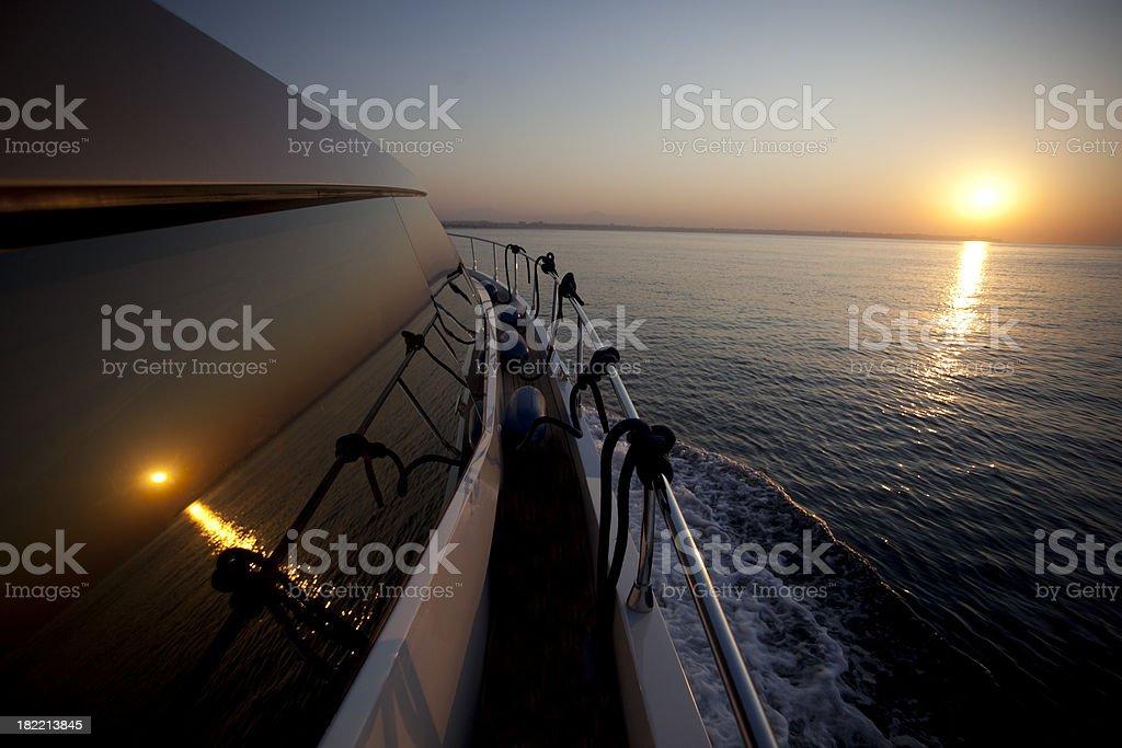 Sunset on yacht window royalty-free stock photo
