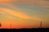 Sunset or dawn sky with a power line silhouette