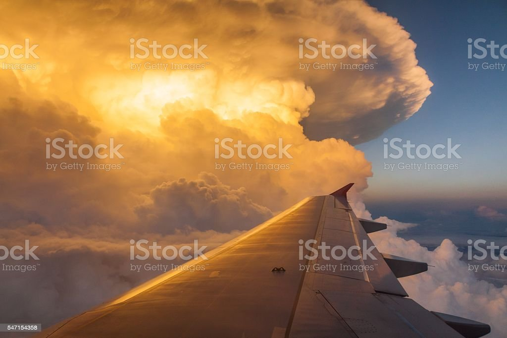 Sunset or sunrise above the cloud view from a plane stock photo