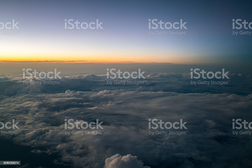 Sunset or sunrise viewed from airplane stock photo