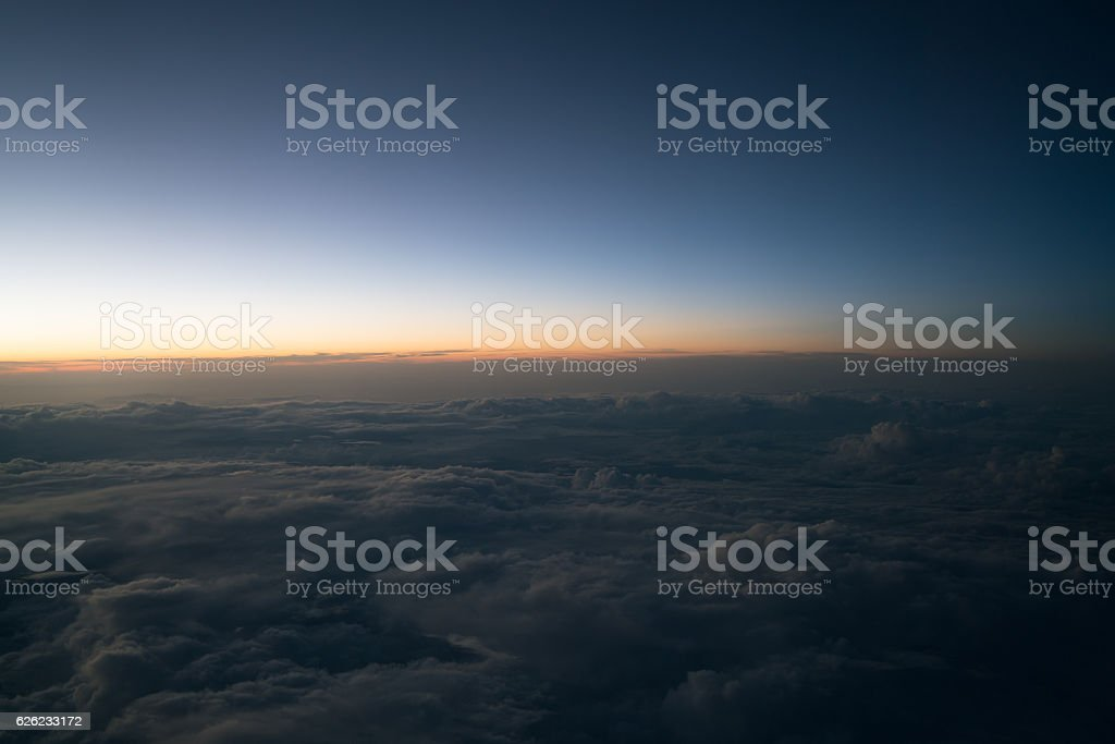 Sunset or sunrise viewed from airplane - foto de stock