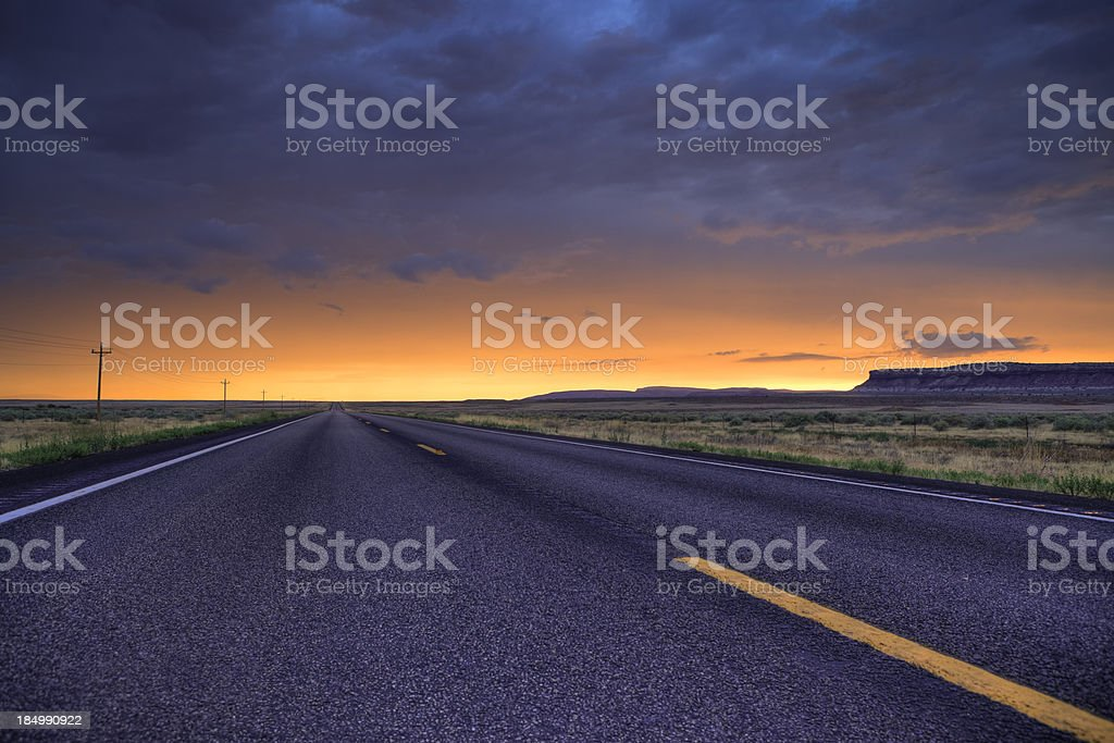 Sunset over a desert road in Utah stock photo