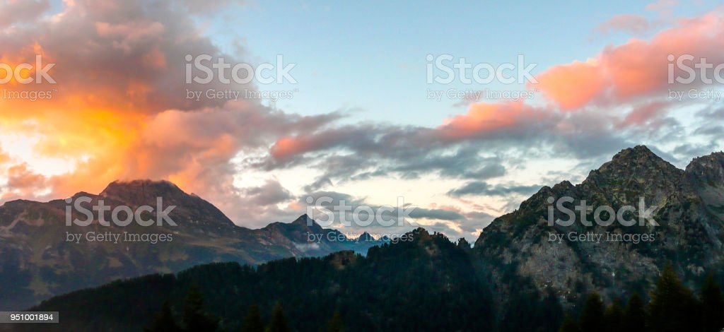 sunset over a fantastic mountain landscape in the Swiss Alps stock photo