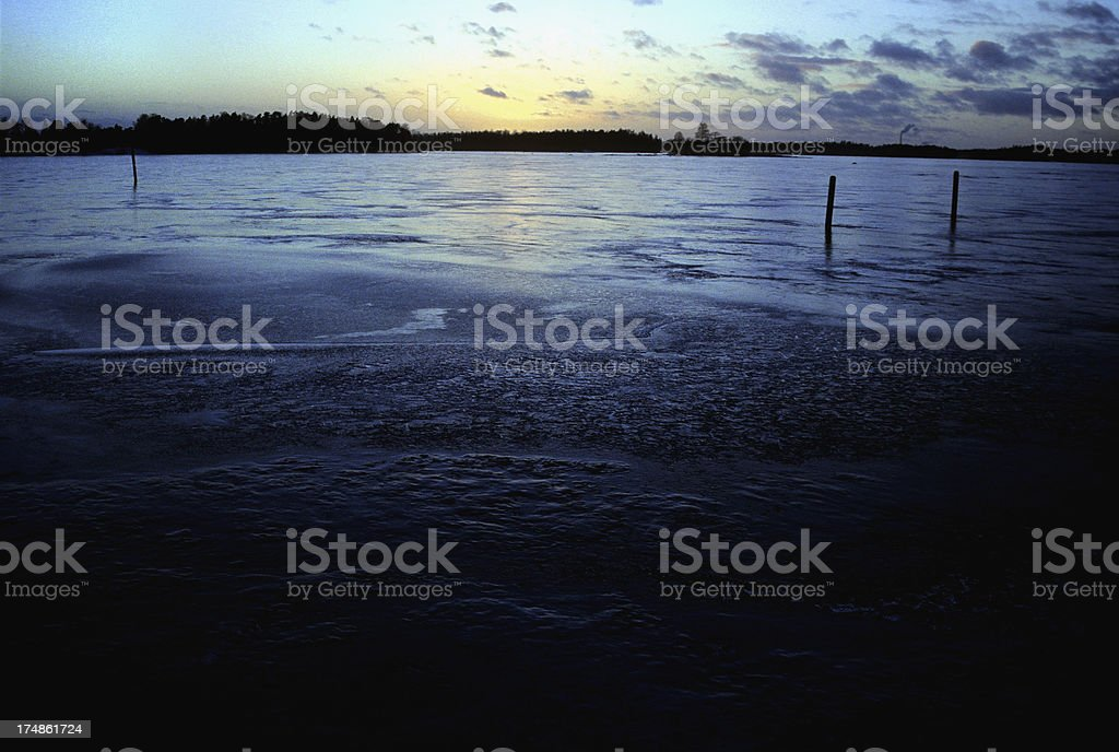 Sunset over a frozen sea royalty-free stock photo
