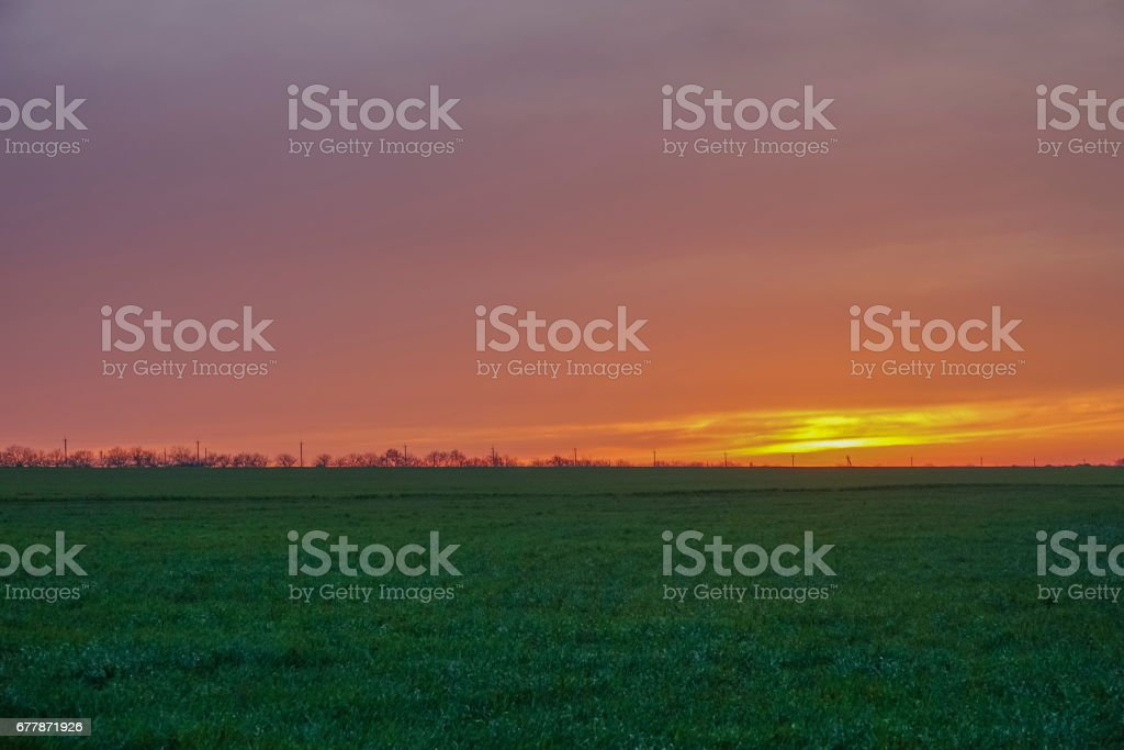 Sunset over a green rural fields royalty-free stock photo
