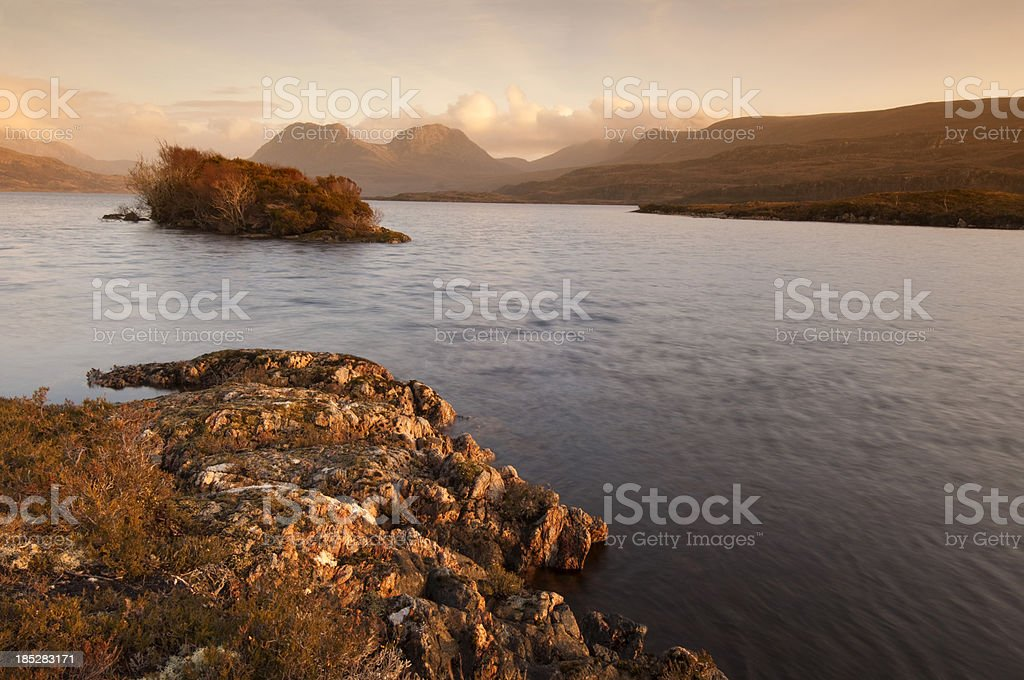 Sunset over a Scottish loch in the Highlands royalty-free stock photo